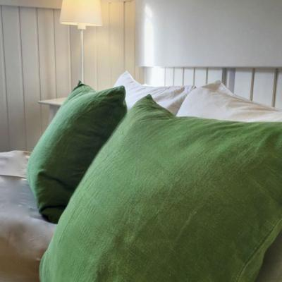 Chambre hambourg coussins verts